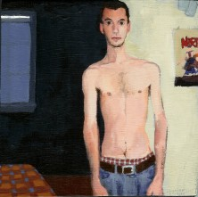White Man With No Shirt in a Living Room