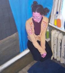 Clothed woman sitting next to bathroom tub
