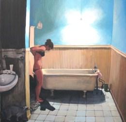 Woman undressing next to bath
