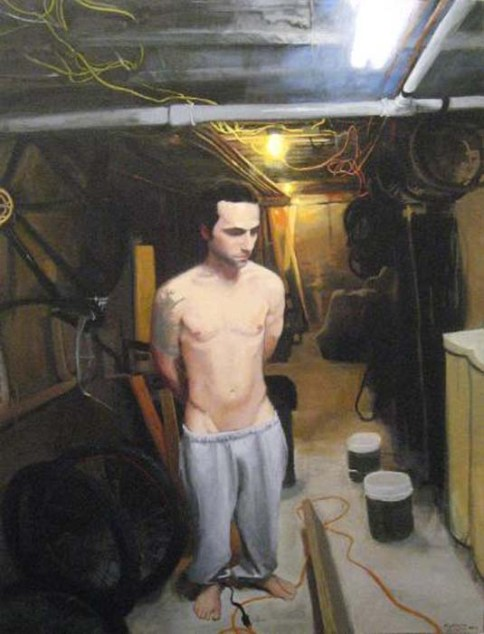 Man in sweatpants and no shirt tied up in the basement