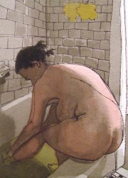 Woman washing feet in a tub