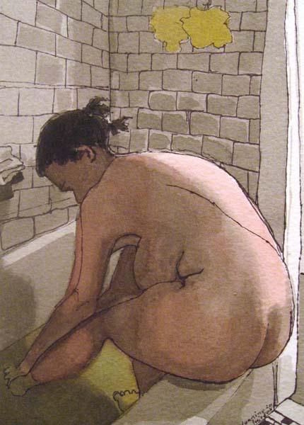 Woman washing feet in a tub