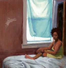 Black woman in a dress on the bed