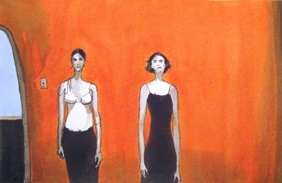 Two women standing in front of an orange