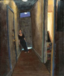 Clothed woman leaning on wall in a hallway