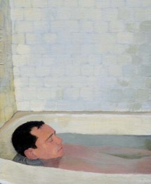Man relaxed and bathing in a tub