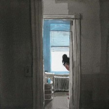 View into bathroom with woman
