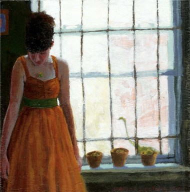 Woman in a dress next to a window