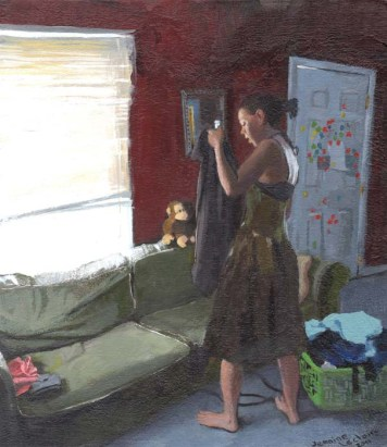 Woman in a Dress Searching a Jacket Next to a Grey Couch