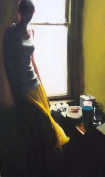 Woman next to a window