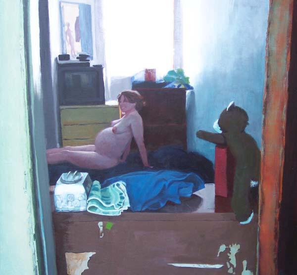 Pregnant nude woman lying on floor