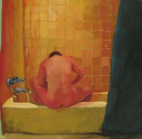 Back view of a person in a bathtub focusing on something in front of them