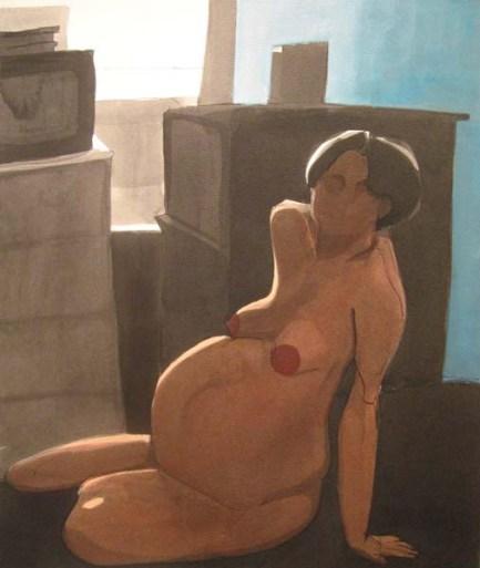 Nude pregnant woman lying on floor