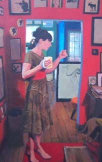 Woman in a Dress with a White Mug in a Red Room