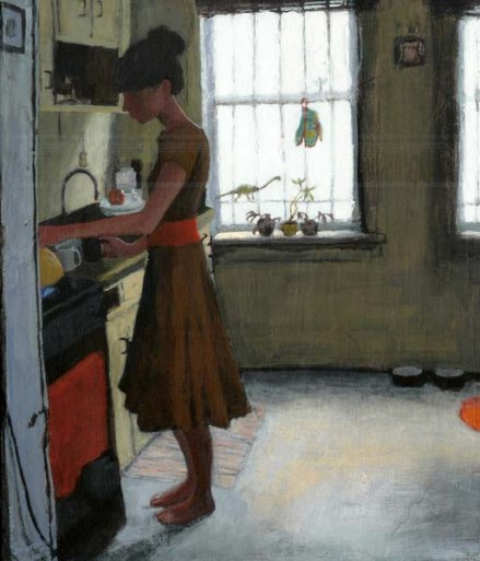 Woman in a dress heating up water in the kitchen