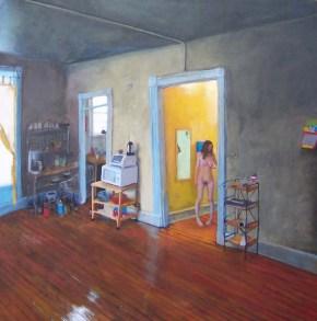 Nude female figure in a room with hardwood floors