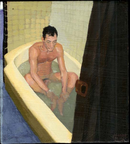 Nude man sitting in a tub