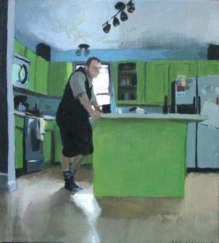 Clothed Man Standing in a Kitchen