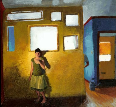 Clothed woman with a skirt in front of a yellow wall