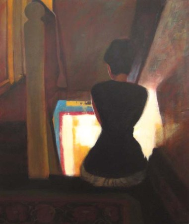 Woman sitting in a starewell