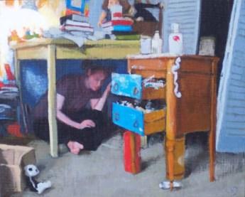 Woman hiding under a desk