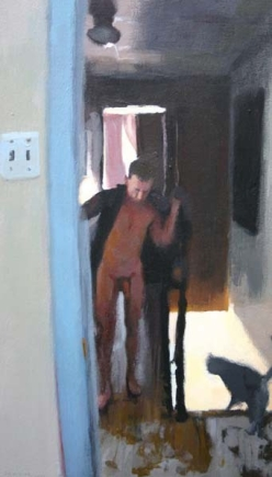 Standing man in a hallway